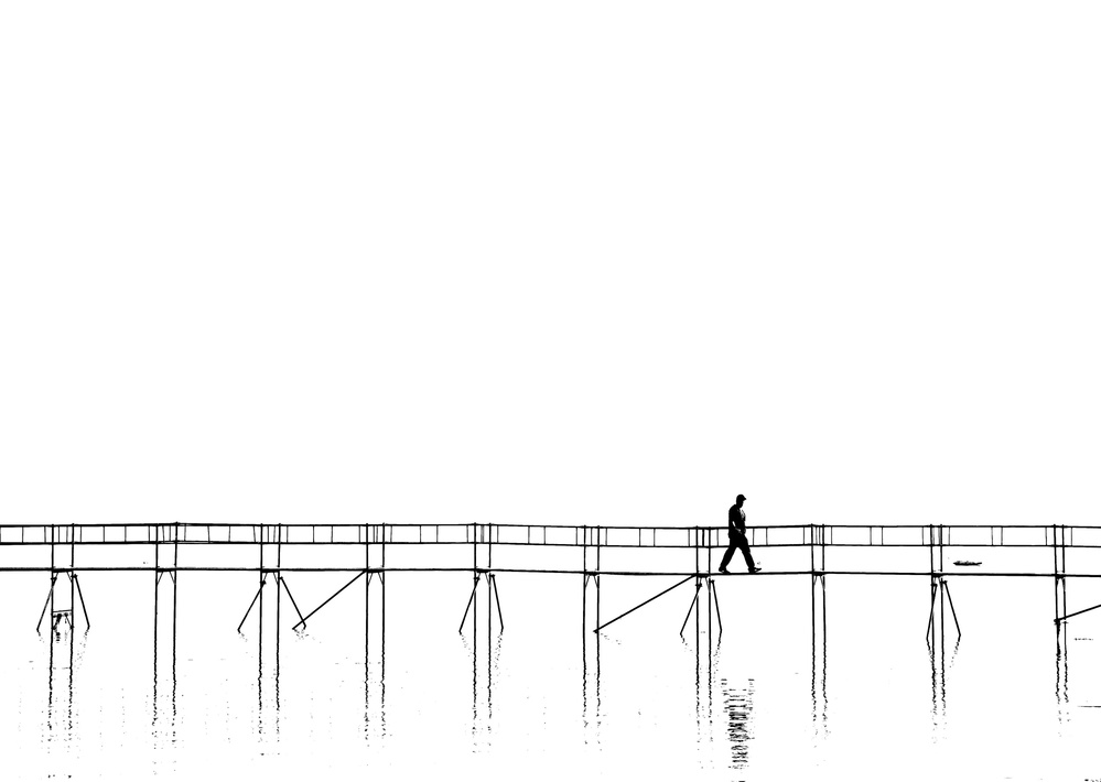 The lonely man on the plank bridge