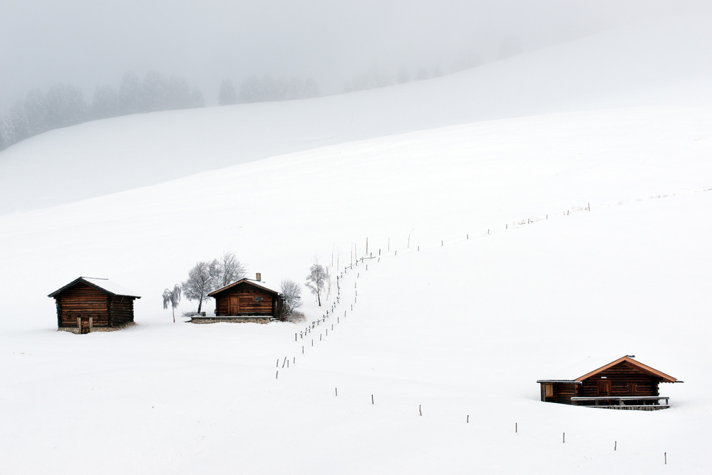 Three huts, snow